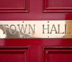 Picture of Town Hall Sign - This is an image of a town hall sign on a door.